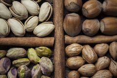 Composition with nuts, hazelnuts and pistachios close up Royalty Free Stock Image