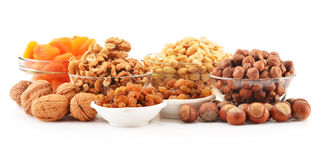 Composition with nuts on white. Background Royalty Free Stock Photography
