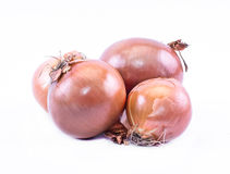 Composition of ocher onions on a white background Royalty Free Stock Images