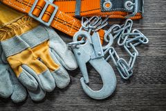 Composition Of Safety Gloves Construction Body Belt On Wooden Bo Royalty Free Stock Image