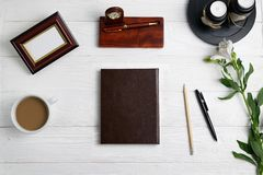 Composition with office education stationary notebook pen pencil coffee flowers stock images