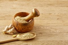 Composition of oil jars, wooden mortar and pestle with ginger and spices on rustic table, close-up, selective focus. Beautiful kitchen still life two transparent stock photo