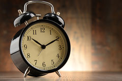 Composition with old black alarm clock Royalty Free Stock Photos