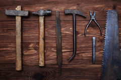 A composition of old carpenter's tools on wooden background Stock Photography