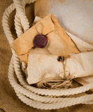 Composition with an old envelope, parchment and rope Royalty Free Stock Image