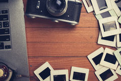 Composition of old photo camera, laptop and photo slides Royalty Free Stock Photo