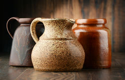 Composition with old pottery. Kitchen dishes Royalty Free Stock Photo