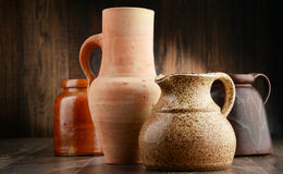 Composition with old pottery. Kitchen dishes.  Stock Photos