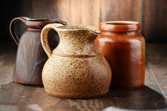 Composition with old pottery. Kitchen dishes Stock Photos
