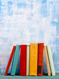 Composition with old vintage colorful hardback books, diary on w Stock Photography