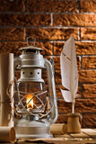 Composition of old writing items and kerosene lamp Royalty Free Stock Photography