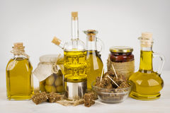 Composition of olive oil bottles and black bread on table.  Royalty Free Stock Images
