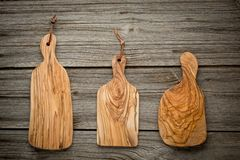 Composition with olive wood board on top of oak Stock Photo