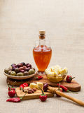 Composition with olive wood, olives, cheese pieces in olive oil, spices Stock Photography