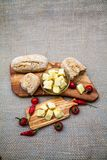 Composition with olive wood, olives, cheese pieces in olive oil, spices Royalty Free Stock Photography