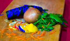 Composition of onion, parsley, cucumber, lemon and pieces of carrot with paint Stock Photo