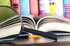 Composition with open book and magnifying glass. Back to school, copy space. Education background. Stock Photography