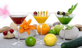 Composition with a orange, cherry and green vegetables cocktails Royalty Free Stock Photography