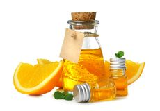 Composition with orange essential oil. On white background royalty free stock photo