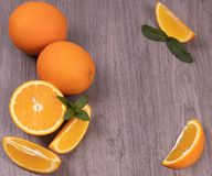 Composition of oranges on a wooden background royalty free stock photos