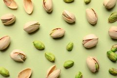 Composition with organic pistachio nuts on color background. Flat lay royalty free stock photos
