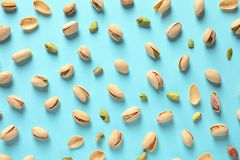 Composition with organic pistachio nuts on color background. Flat lay stock image