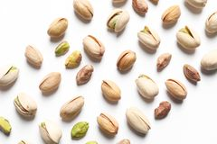 Composition with organic pistachio nuts on white background. Top view royalty free stock images