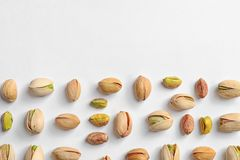 Composition with organic pistachio nuts on white background, top view. Space for text stock photography