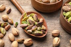 Composition with organic pistachio nuts on wooden table. Closeup stock image