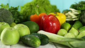 Composition with organic vegetables on the wooden table stock video footage