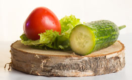 The composition of organically grown vegetables cucumbers, tomatoes, lettuce Royalty Free Stock Photo
