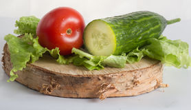The composition of organically grown vegetables cucumbers, tomatoes, lettuce Stock Photos