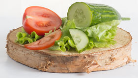 The composition of organically grown vegetables cucumbers, tomatoes, lettuce Stock Photo