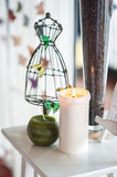 Composition with ornament, candle and butterfly Stock Photography
