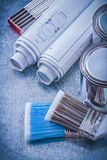 Composition of paint brushes cans construction drawings wooden m Stock Images