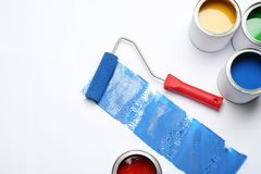 Composition with paint cans and roller brush on white. Background royalty free stock photo
