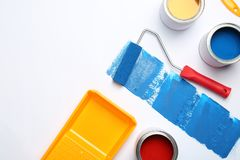 Composition with paint cans and space for text on white. Background royalty free stock photography