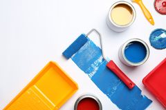 Composition with paint cans and space for text on white. Background stock photography