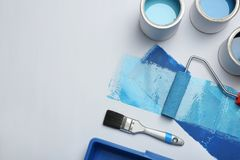 Composition with paint cans on white background stock photography