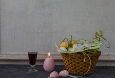 Composition of painted Easter eggs on dark stone table and vintage white wall background royalty free stock photography
