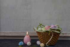 Composition of painted Easter eggs on dark stone table and vintage white wall background stock photos