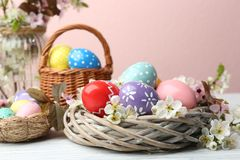 Composition with painted Easter eggs and flowers. On table royalty free stock photos