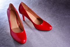 Composition with a pair of red high heel shoes Royalty Free Stock Images