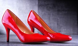 Composition with a pair of red high heel shoes Stock Photo
