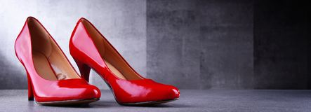 Composition with a pair of red high heel shoes Royalty Free Stock Photos