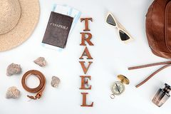 Composition with passport, immigration bureau cards, compass and word \'Travel\' on white background royalty free stock image