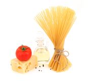 Composition of pasta tomato cheese oil pepper. Stock Photo