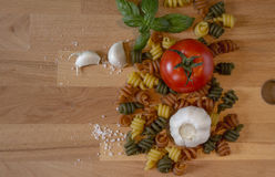 Composition with pasta and tomato. Pasta with a tomato, garlic, basil and some salt Royalty Free Stock Image