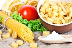 Composition of pasta, tomato and salad Royalty Free Stock Photos