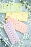 Composition with pastel colors chocolate bars Stock Photo
